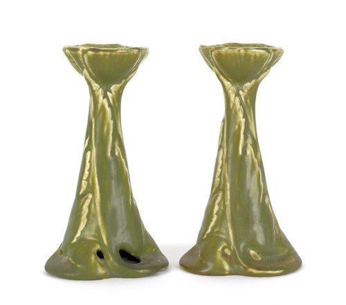 24: Pair of Rookwood pottery candlesticks, 6 3/4'' h.