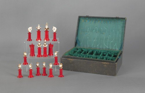 71: Carved ivory chess set with case.
