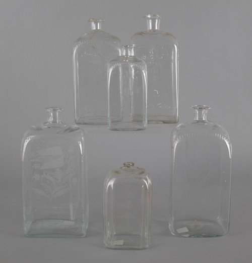 761: Six etched colorless glass bottles, 19th c., tall