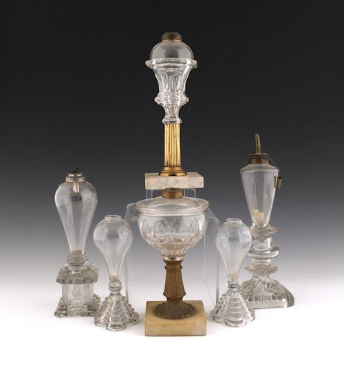 769: Six New England colorless glass whale oil lamps,