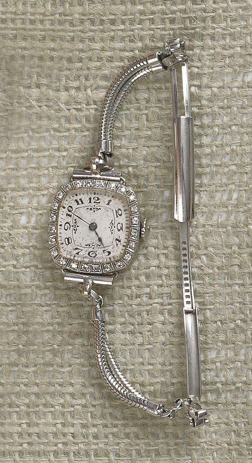 815: 20K gold and diamond lady's wristwatch.