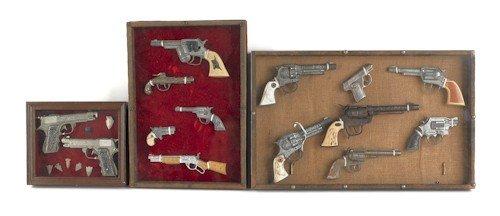 856: Fourteen framed cap guns, 20th c., most Hubley.