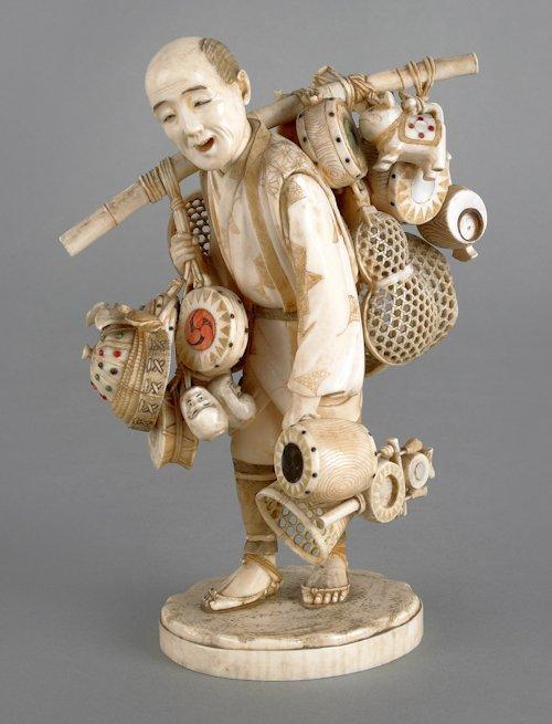 198: Japanese carved ivory figure of a peddler, ca. 1