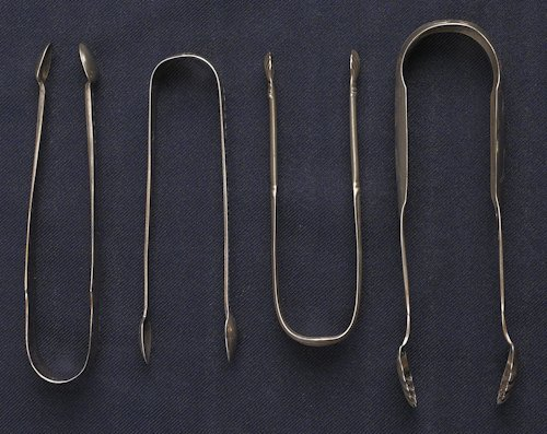 47: Collection of silver tongs to include sugar ton