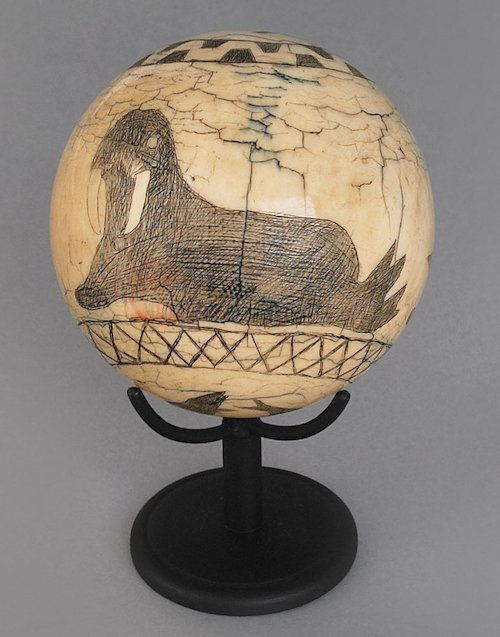99: New England scrimshaw decorated ivory ball, 19th