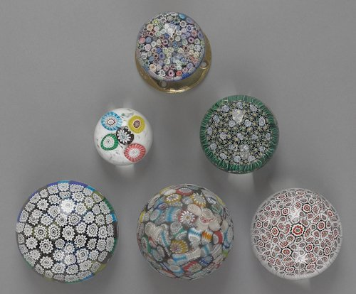 64: Six millefiori glass paperweights, to include two