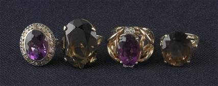 490: Two smoky quartz rings, 10K yellow gold and 14K y