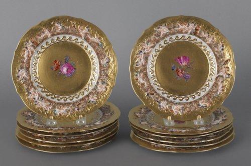 674: Set of twelve Capo di Monte plates with relief pu