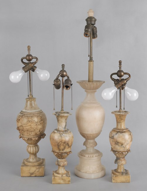 679: Four marble and alabaster table lamps, tallest -