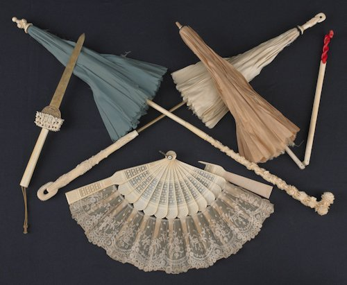 691: Three Chinese ivory handled parasols, together wi