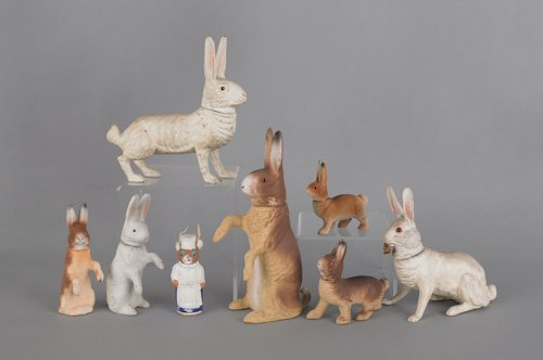 9: Eight composition rabbit candy containers, late 1