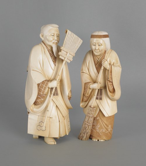 1249: Pair of Japanese carved elephant ivory of a man a