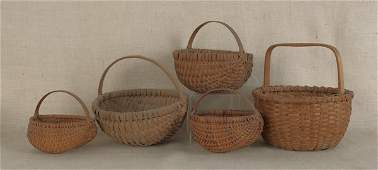 288: Five split oak baskets, largest - 14'' h., 13'' di