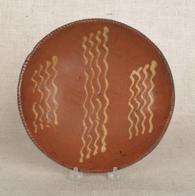 12: Pennsylvania redware pie plate, 19th c., with y