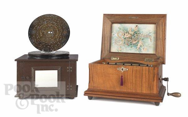 4: Symphonion disc music box with a burl walnut case