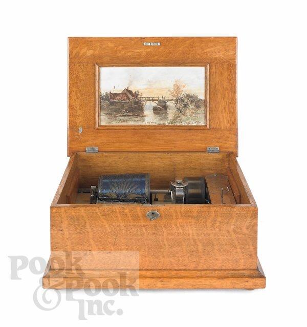 15: Oak Capitol Cuff music box, 19th c., with eightee