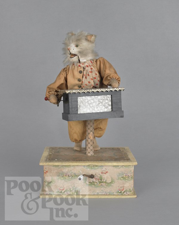 17: Musical automaton of a cat playing an organ grind