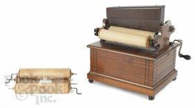 23: Organ grinder walnut music box, ca. 1900, with fi