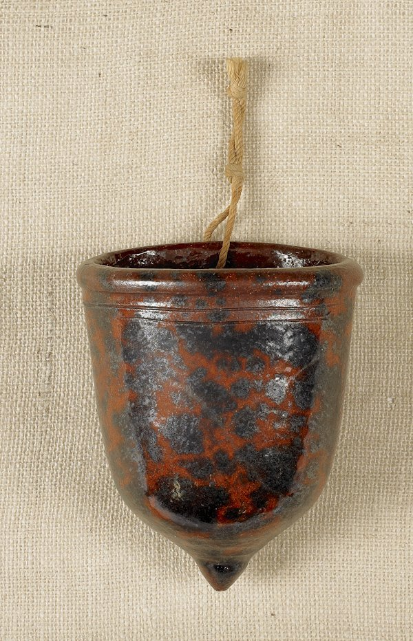 18: Pennsylvania redware wall pocket, 19th c., with