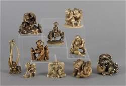 Ten Japanese carved ivory netsuke, probably Meiji