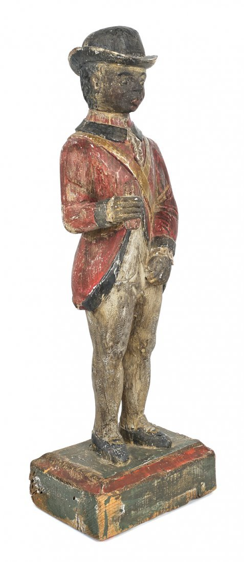 Carved and painted pine figure of a black soldie
