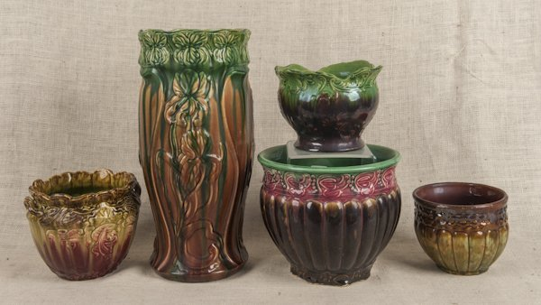 Four Majolica planters, together with an umbrella