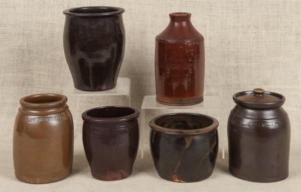 Six Pennsylvania redware and stoneware crocks, 19