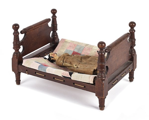 Tiger maple doll's bed, 19th c., 8 3/4'' h., 9 1/2