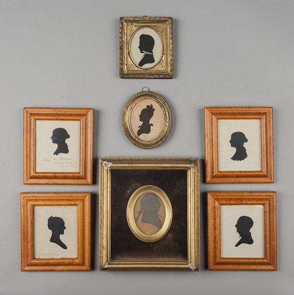Collection of seven hollow cut silhouettes.