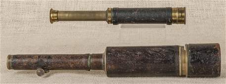 Two leather covered brass spy glasses, 19th c., o