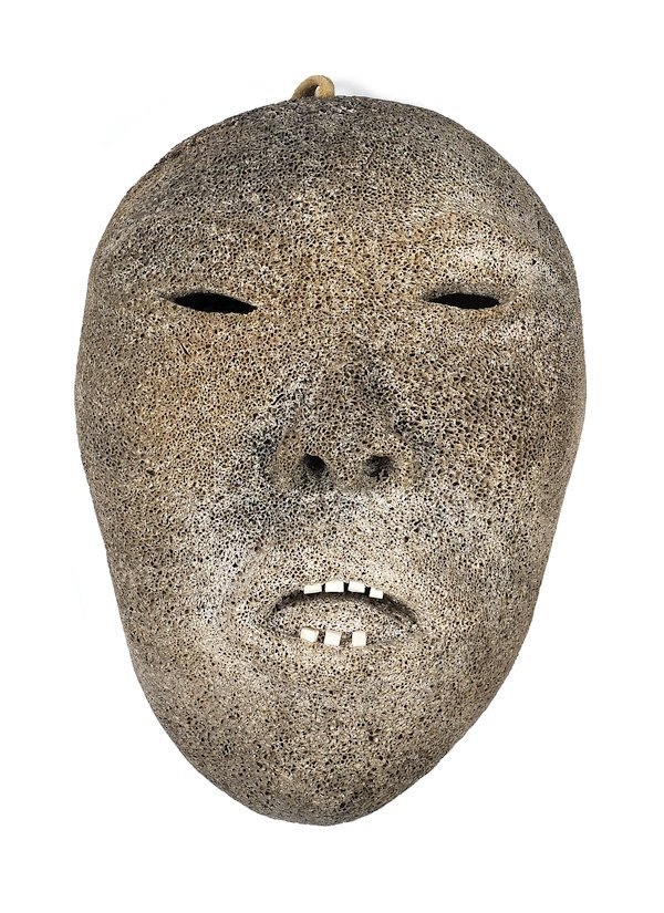 Northwest coast carved whale bone mask, 19th c.,