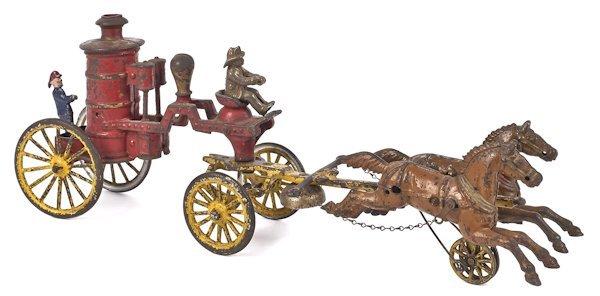 Dent cast iron horse drawn fire pumper, 20'' l.