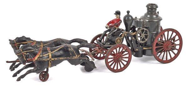 Cast iron horse drawn fire pumper, 18'' l.