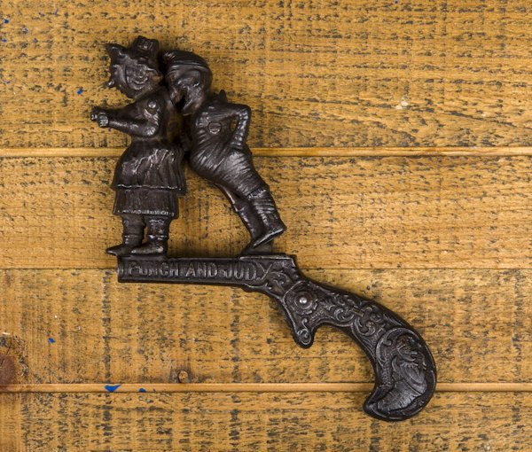 Ives cast iron Punch and Judy animated cap gun,