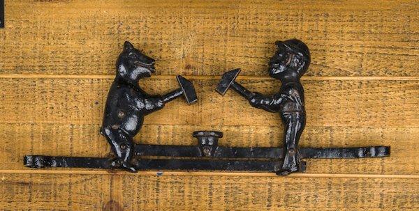 Ives cast iron Sambo and the bear cap toy, 13'' l.