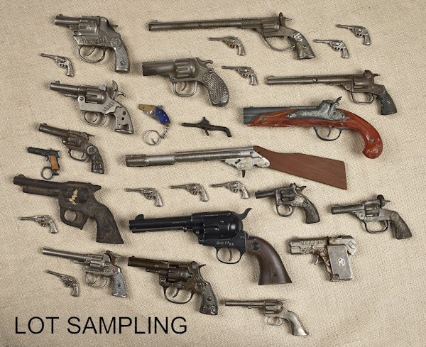 Collection of fourteen cap guns, together with mi