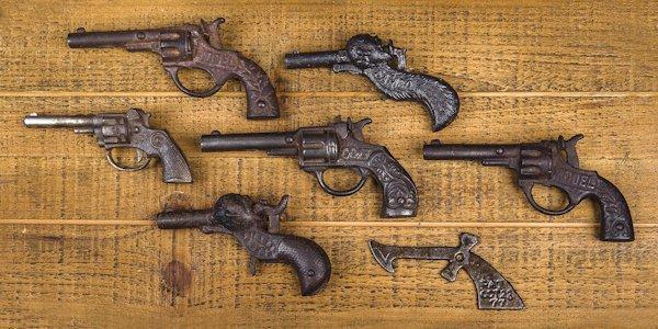 Two cast iron Sambo figural cap guns, 4 1/4'' l.