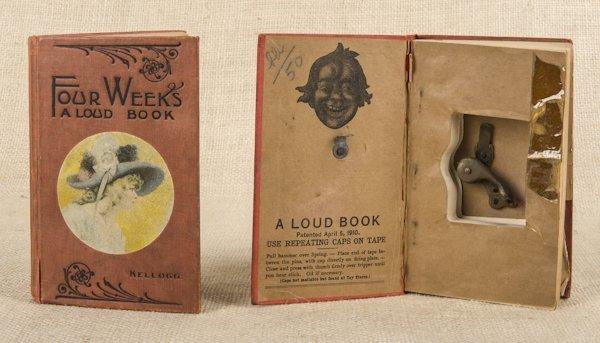 Two cap gun Loud Books, 5 3/4'' x 3 3/4''.