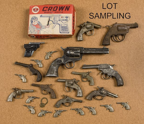 Group of cast iron, nickel, and tin cap guns, to