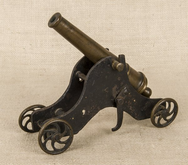 Cast iron and brass model cannon, 8 3/4'' l.