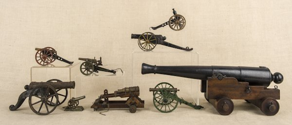 Nine cast iron and wood cannons, to include one