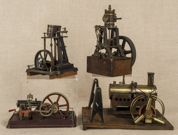 Four cast iron live steam toy engines, tallest -
