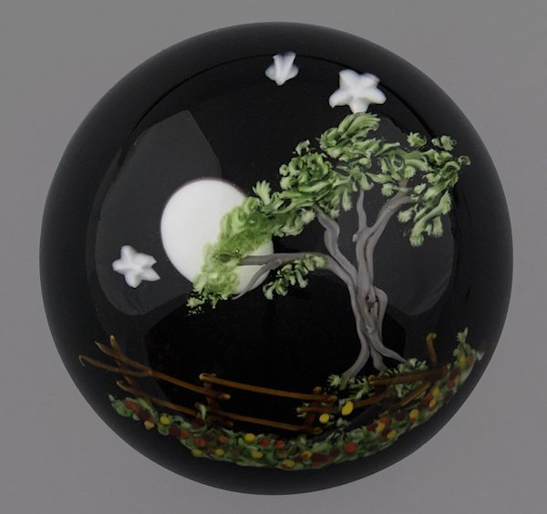 Mayauel Ward paperweight with a moon and an oak t