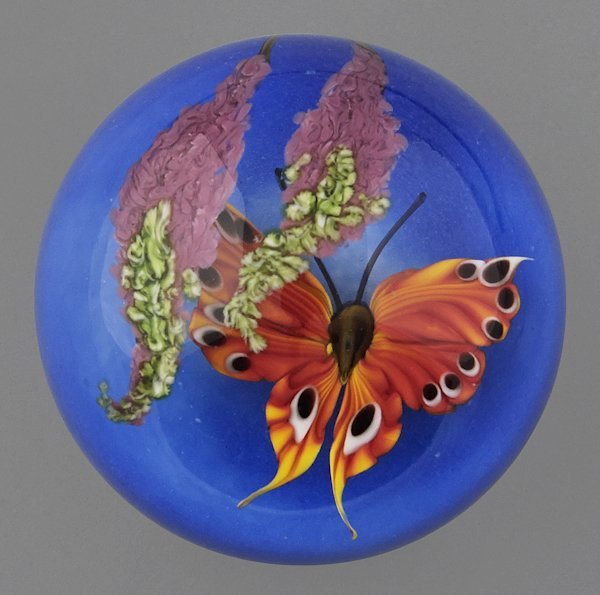 Mayauel Ward paperweight with a butterfly and wis