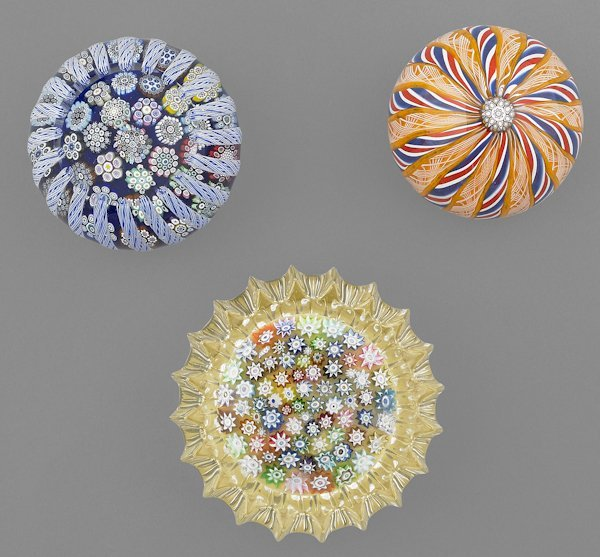 Three Peter McDougal paperweights, to include a c