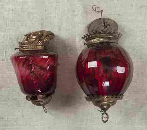 Two Victorian cranberry glass hanging lamps, late