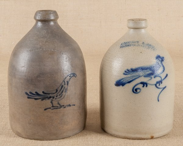 Two stoneware jugs, 19th c., with cobalt bird d