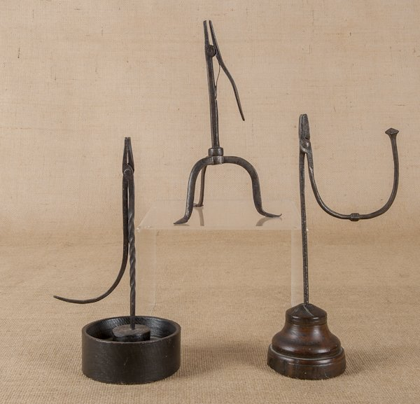 Three Continental wrought iron rush lights, earl
