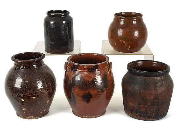 Five redware crocks, 19th c., to include an ungla
