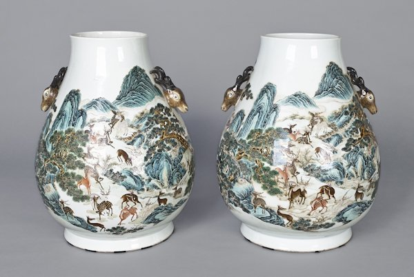 Pair of Chinese porcelain vases with deer in land